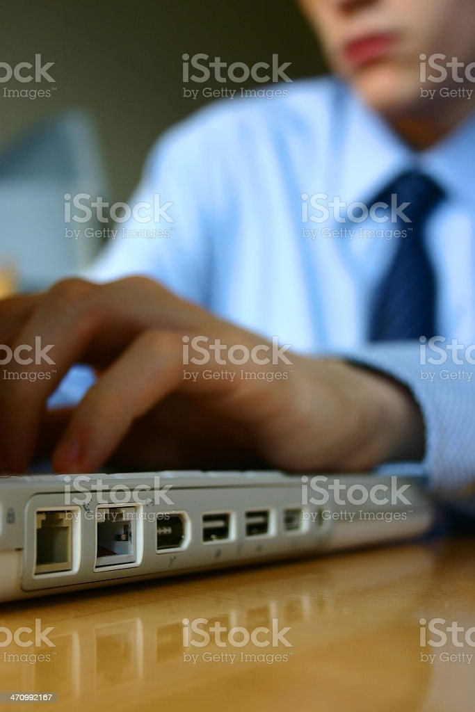 Businessman working on laptop at his desk stock photo