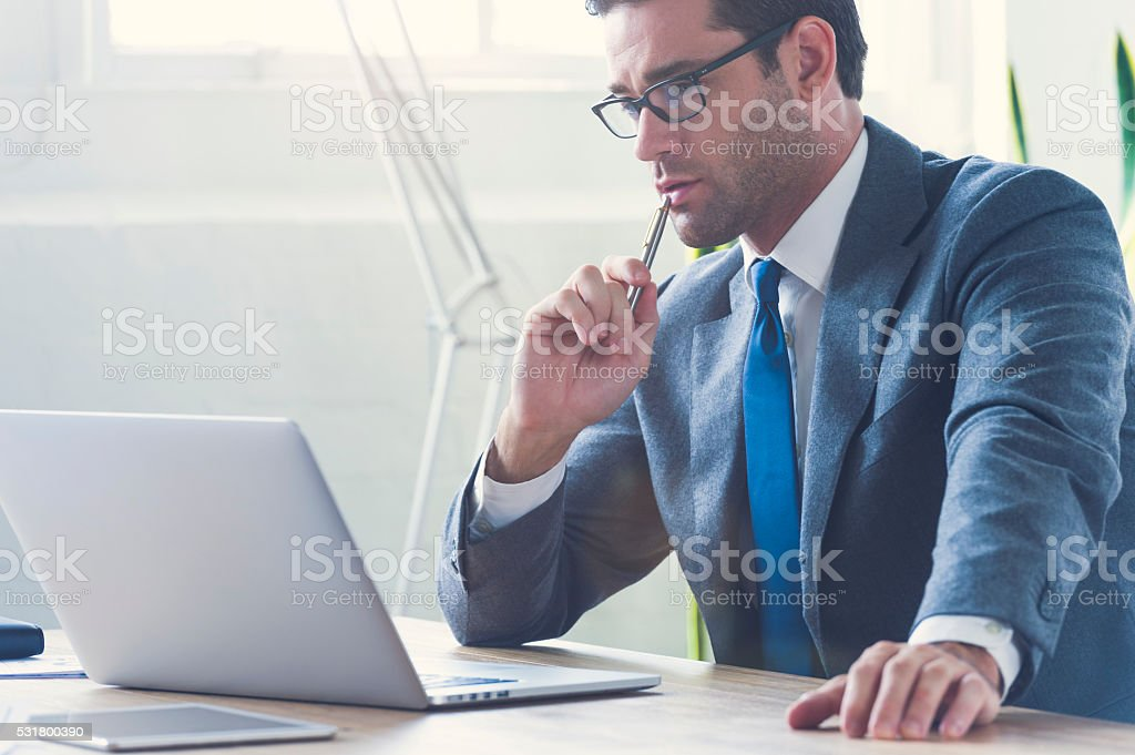 Businessman working on laptop computer. stock photo