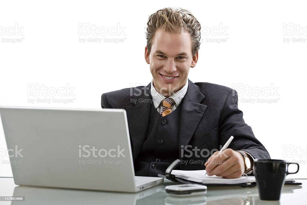 Businessman working on laptop isolated royalty-free stock photo