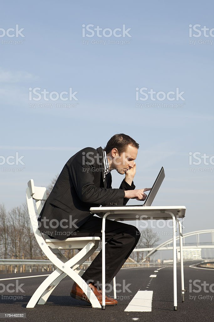Businessman Working On Laptop, Main Road royalty-free stock photo