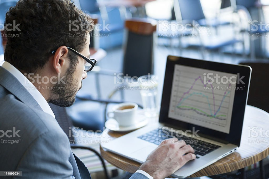 Businessman working on laptop royalty-free stock photo