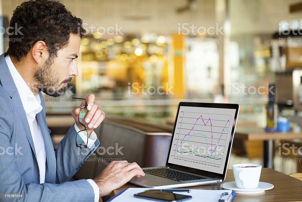Businessman working on laptop stock photo