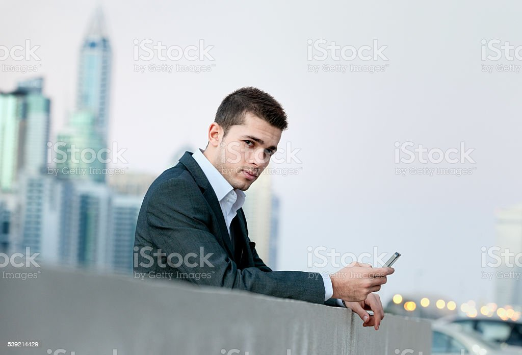 businessman working on smart phone in business centre stock photo