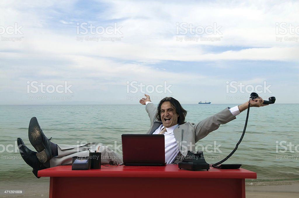 Businessman working on the beach royalty-free stock photo