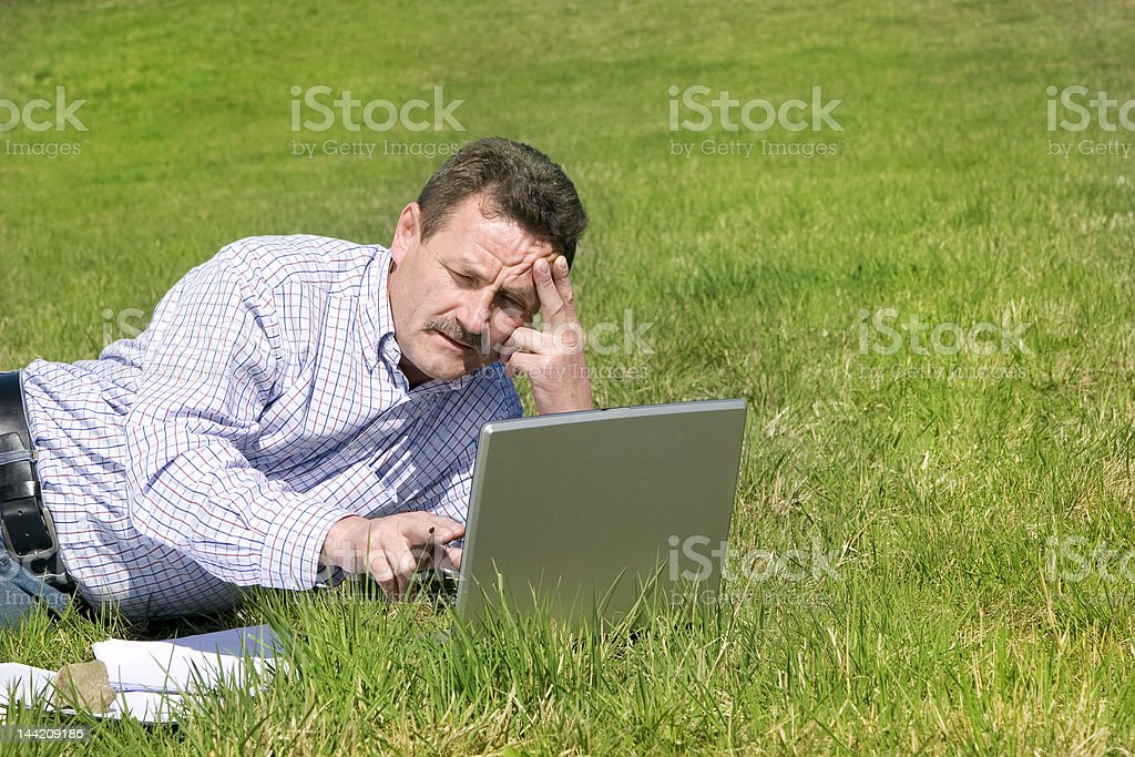 Businessman working outside royalty-free stock photo
