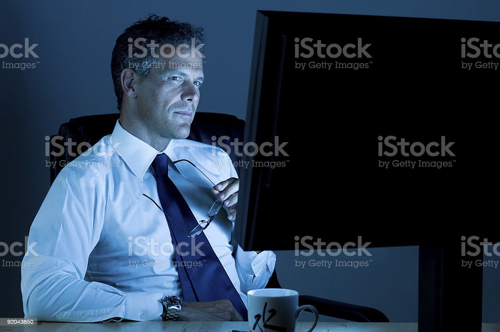 Businessman working till late royalty-free stock photo