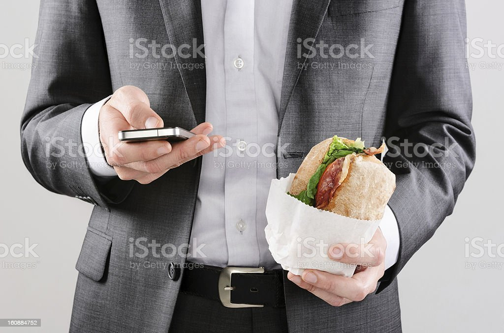 Businessman working while having lunch royalty-free stock photo