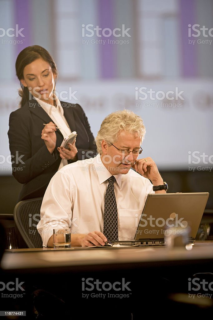 Businessman Working With A Co-Worker royalty-free stock photo