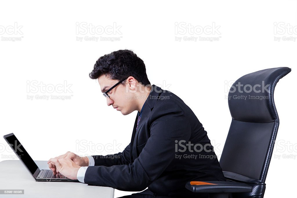 Businessman working with a laptop stock photo