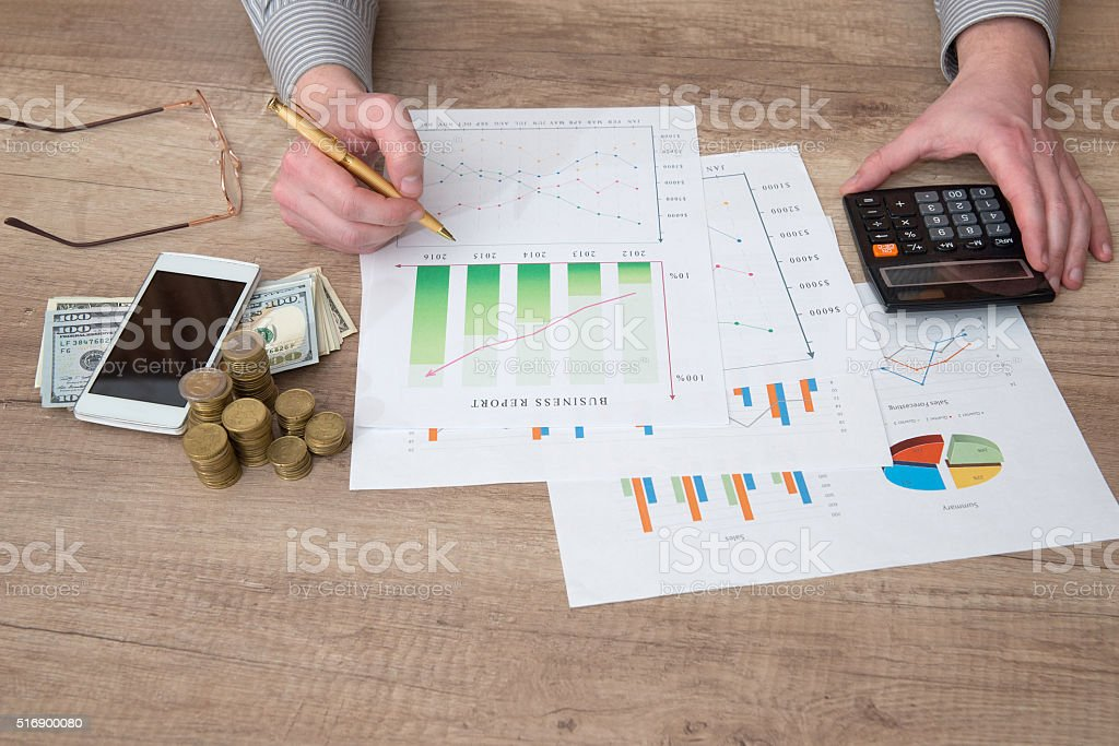 businessman working with business graph in office stock photo