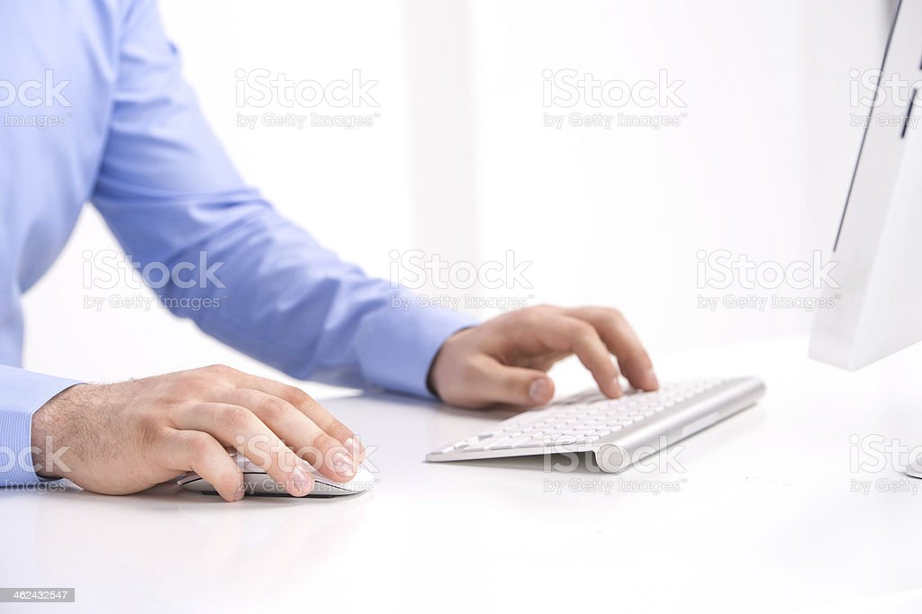 Businessman working with desktop computer. stock photo