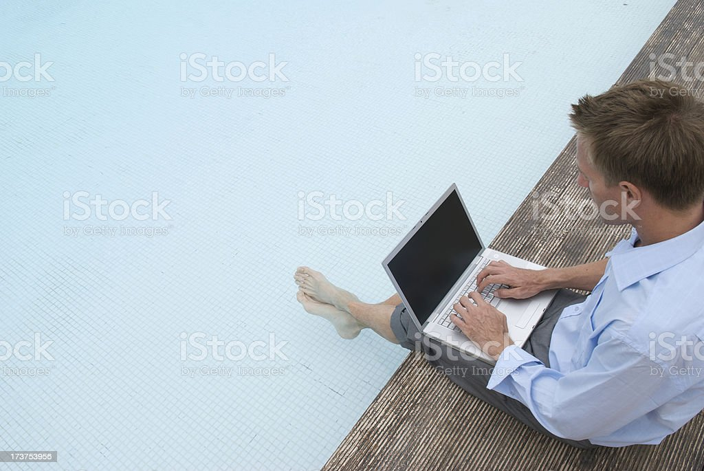 Businessman Working with Feet in the Swimming Pool royalty-free stock photo