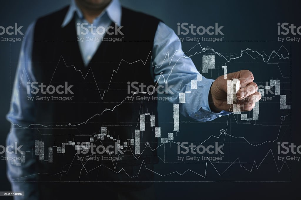Businessman working with financial chart stock photo