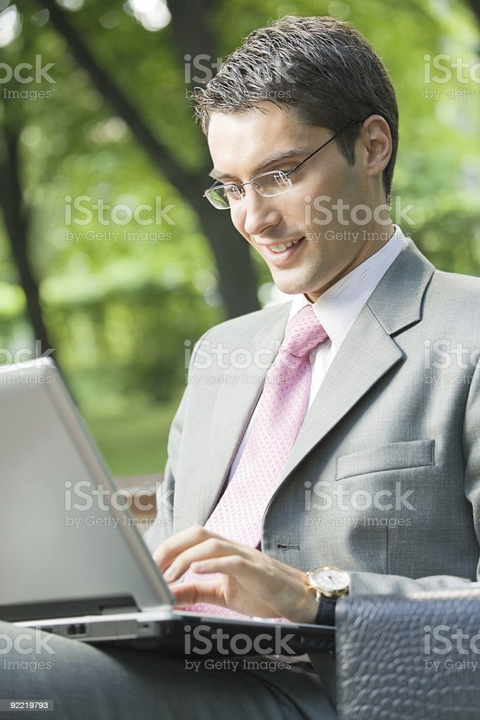 Businessman working with laptop, outdoors royalty-free stock photo