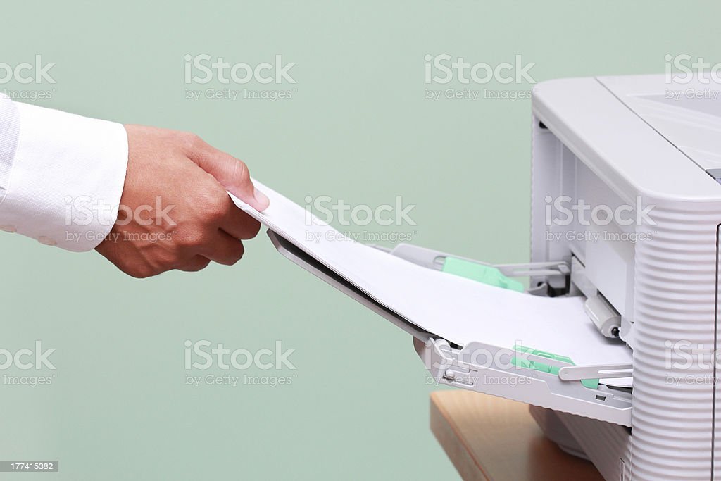Businessman working with printer stock photo