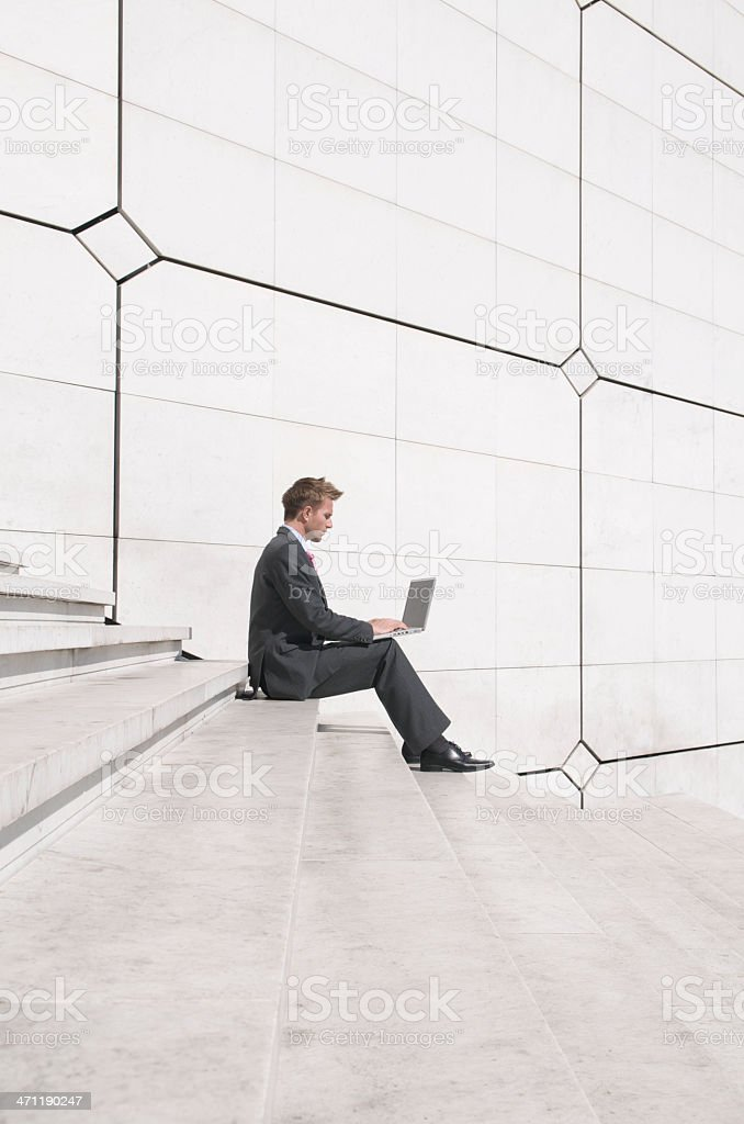 Businessman Works on Steps royalty-free stock photo