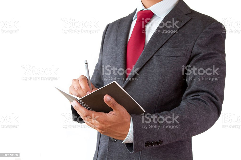 Businessman write planning on notepad with pen isolated stock photo