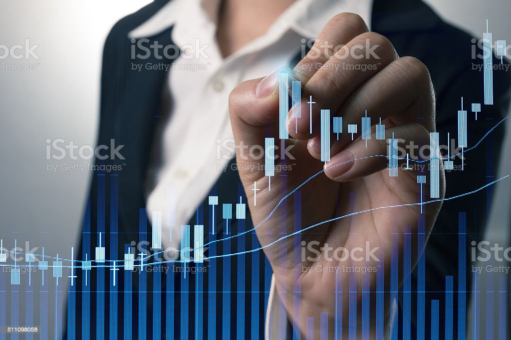 Businessman writing analyze graph for trade stock market on the stock photo