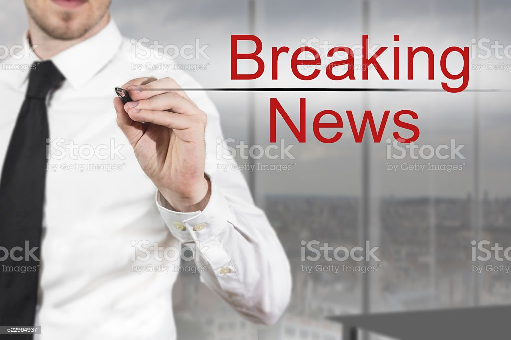 businessman writing breaking news in the air stock photo