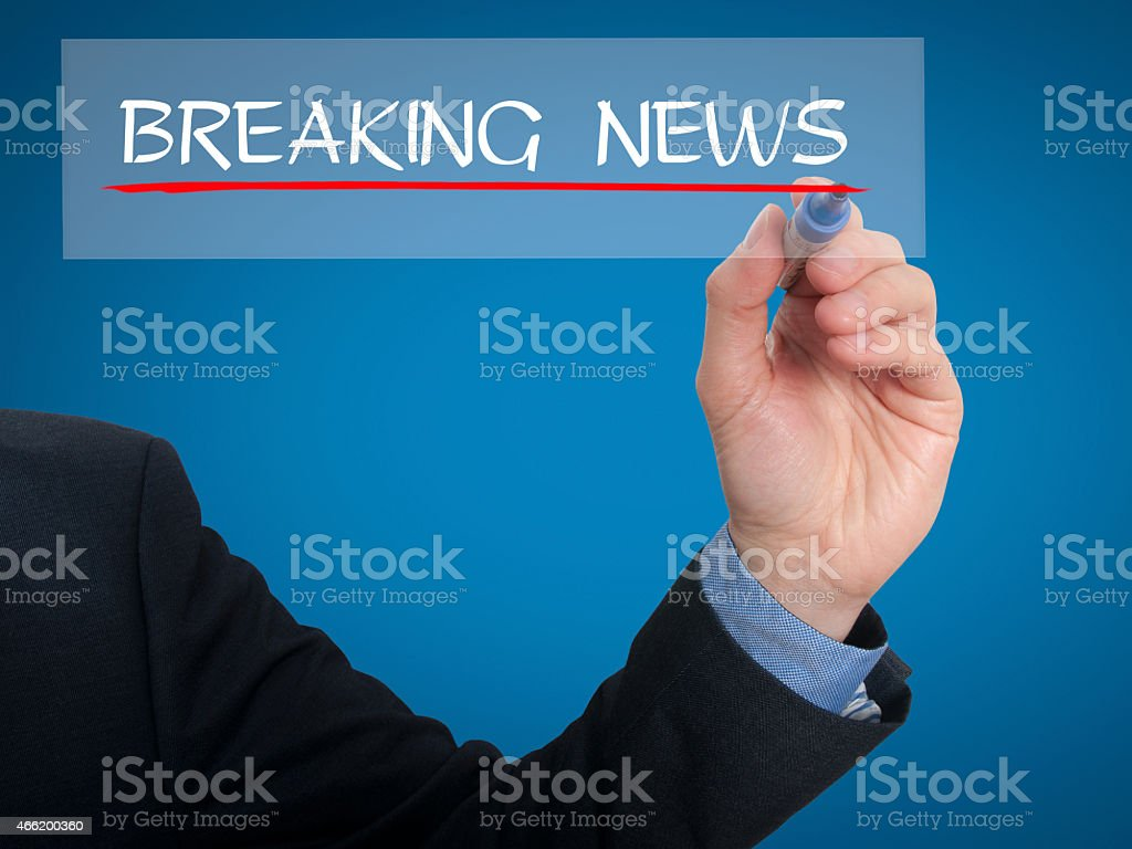 Businessman writing breaking news in the air - Stock Image stock photo