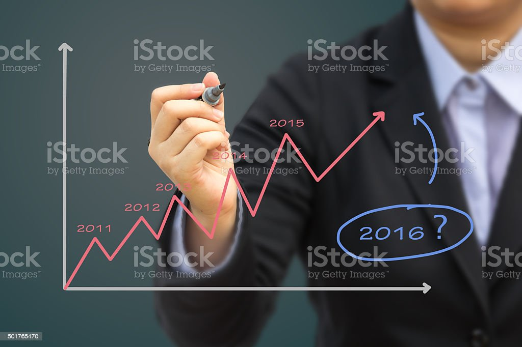 Businessman writing Estimate graph for year 2016 (Pastel tone). stock photo