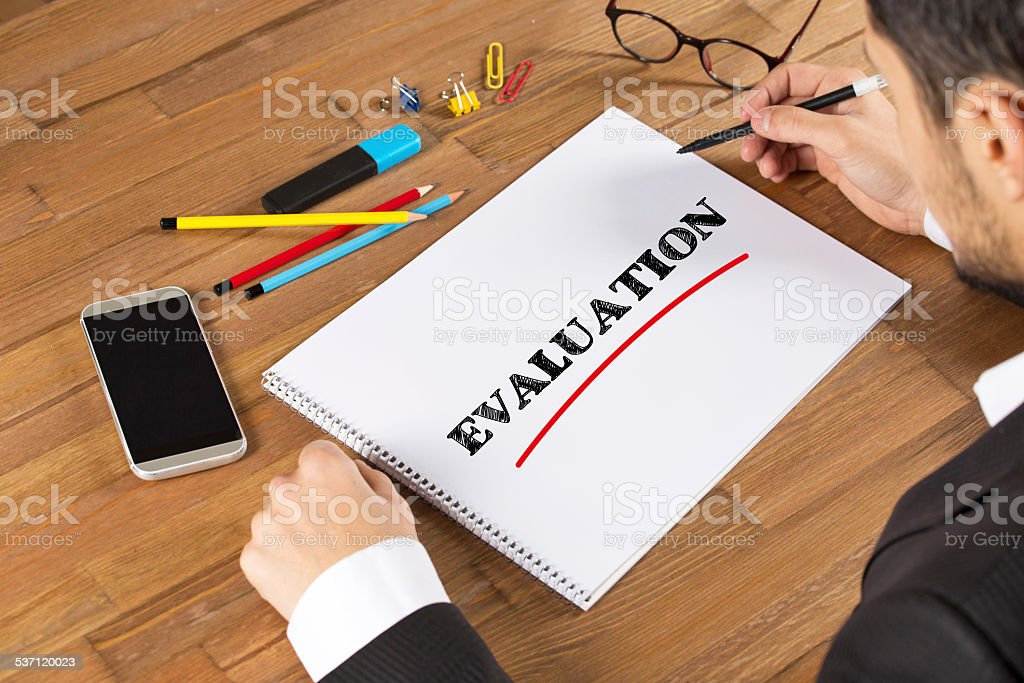 Businessman Writing Evaluation stock photo