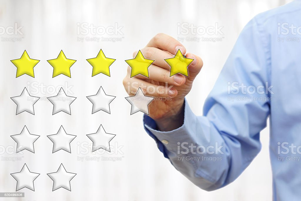 businessman writing  five star rating stock photo