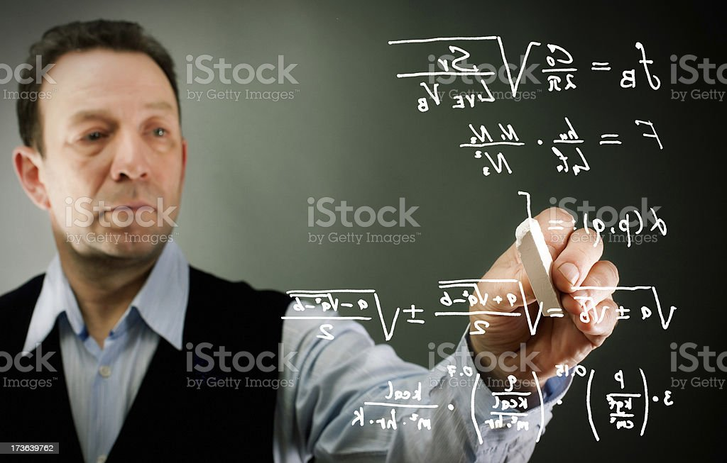 Businessman writing formulas royalty-free stock photo