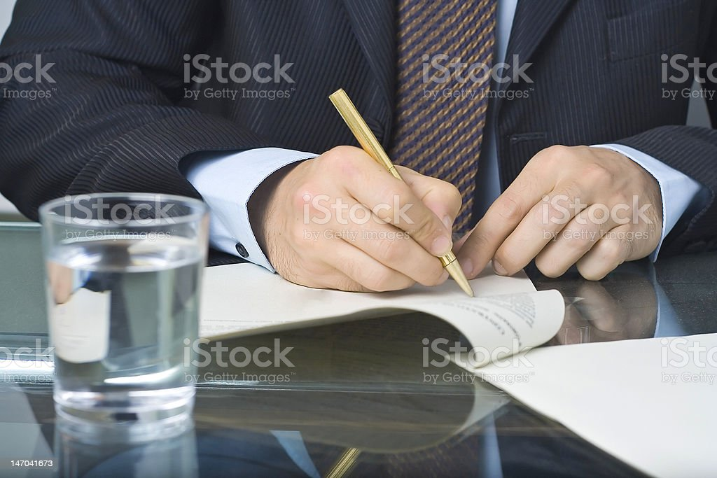 businessman writing in a document royalty-free stock photo