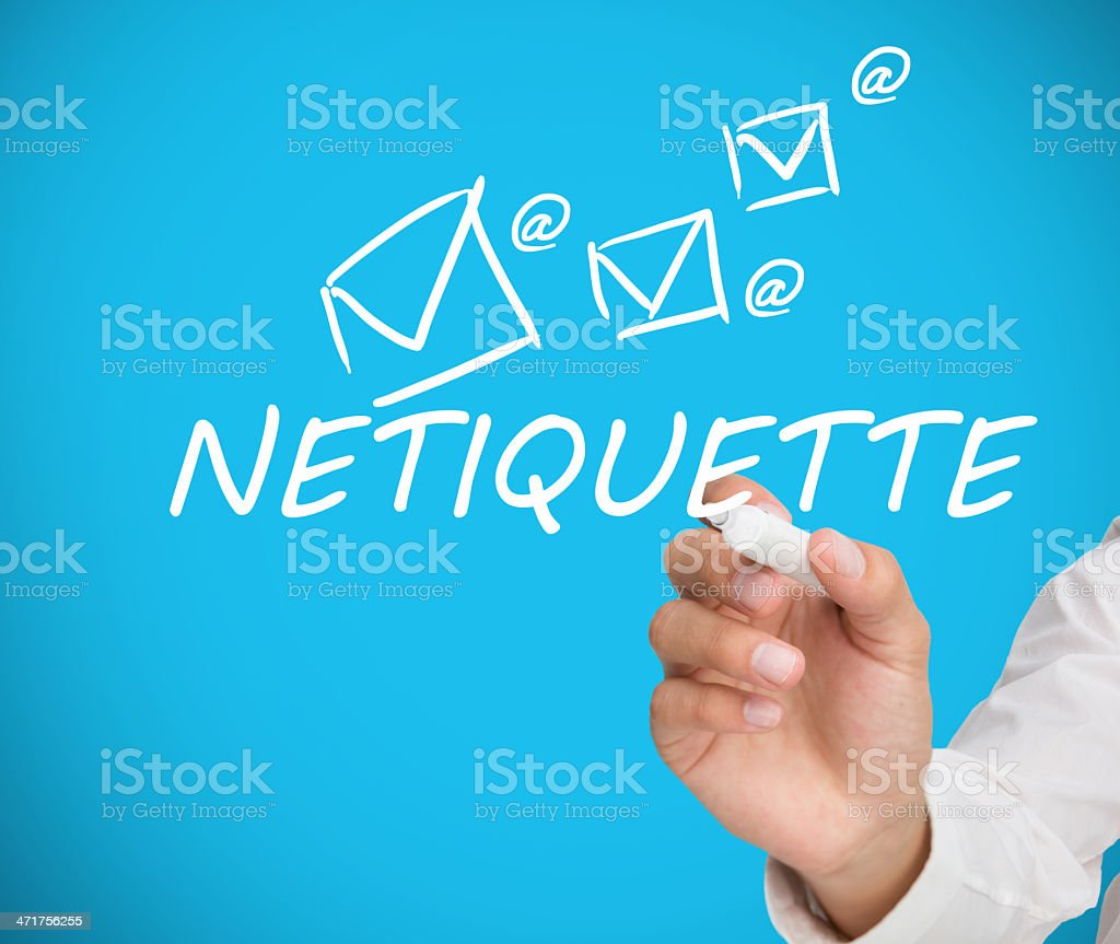 Businessman writing netiquette stock photo