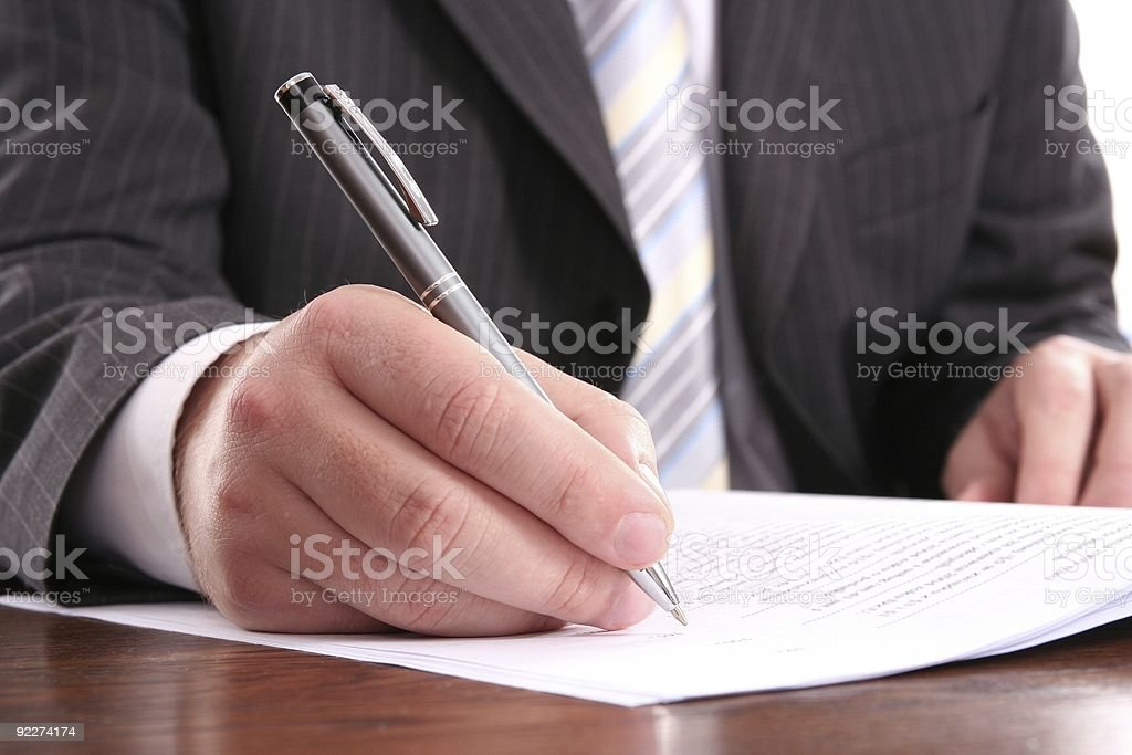 businessman writing on a form, signing document stock photo