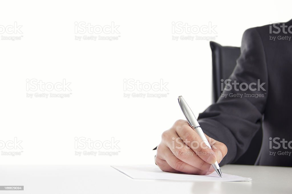 Businessman writing on a paper royalty-free stock photo