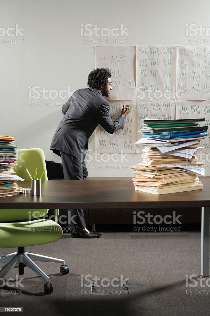 Businessman writing on a tally chart stock photo