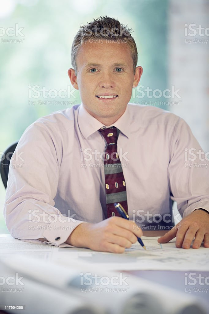 Businessman  Writing On Blueprints royalty-free stock photo