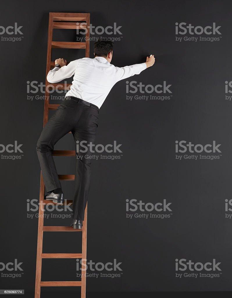 Businessman writing on huge blackboard stock photo