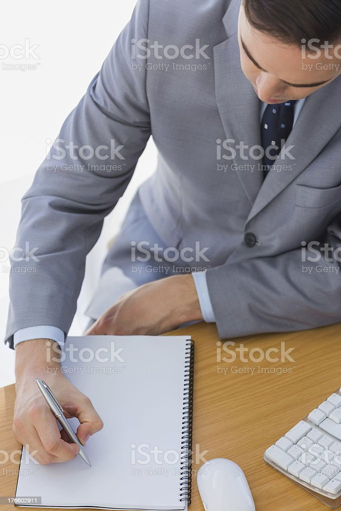 Businessman writing on notepad royalty-free stock photo