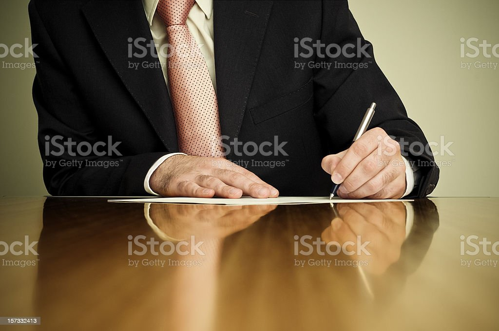 Businessman writing paper royalty-free stock photo
