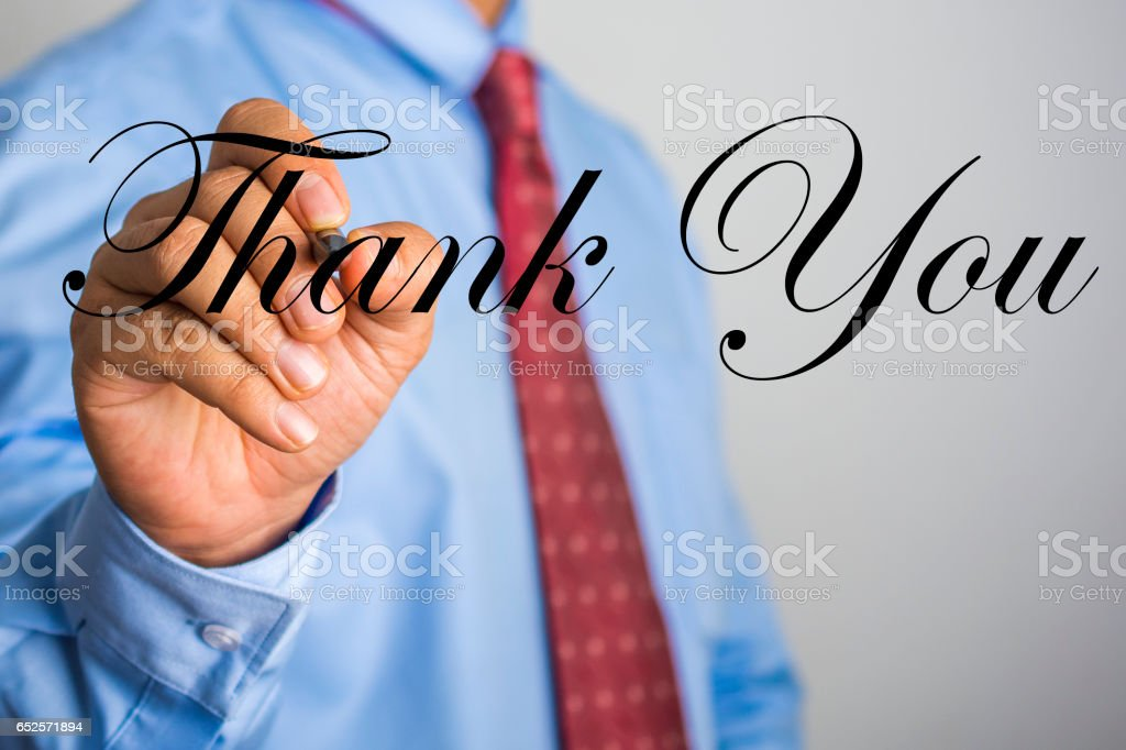 Businessman writing Thank You word on virtual screen. stock photo