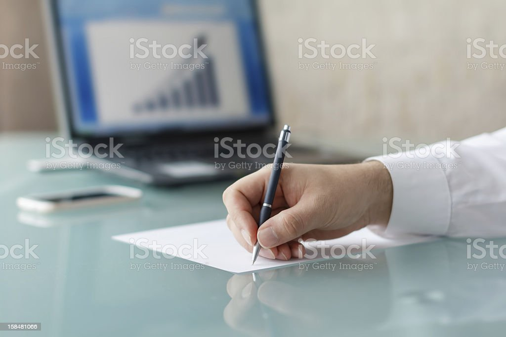 Businessman writing with pen royalty-free stock photo