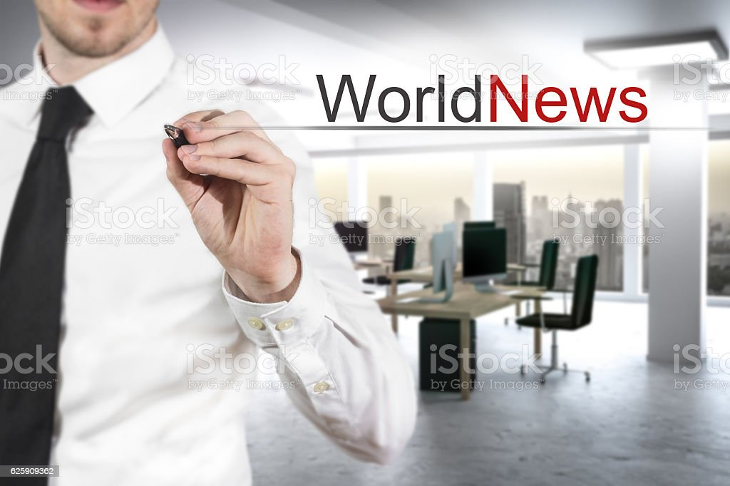 businessman writing world news in the air stock photo