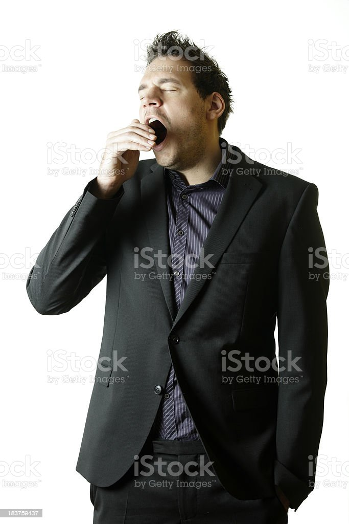 Businessman yawning royalty-free stock photo