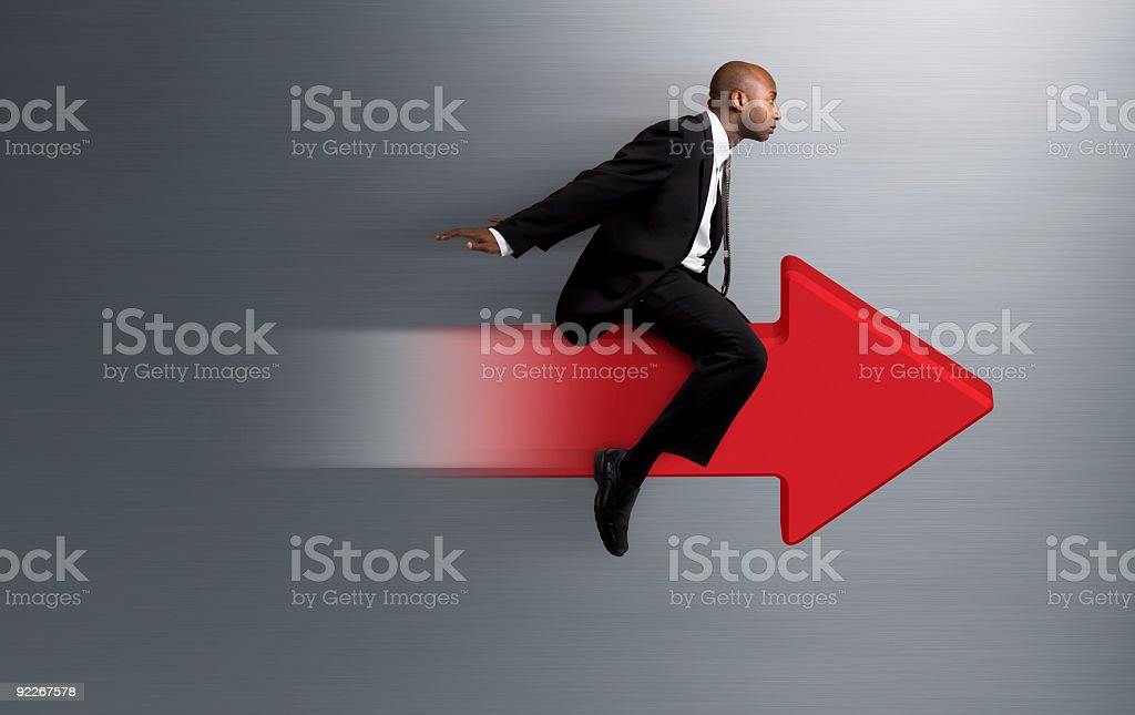 Businessman Zooming Ahead stock photo