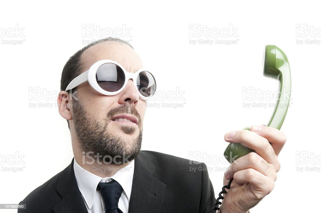 Businessmanon the phone, shrugging, annoyed by caller royalty-free stock photo