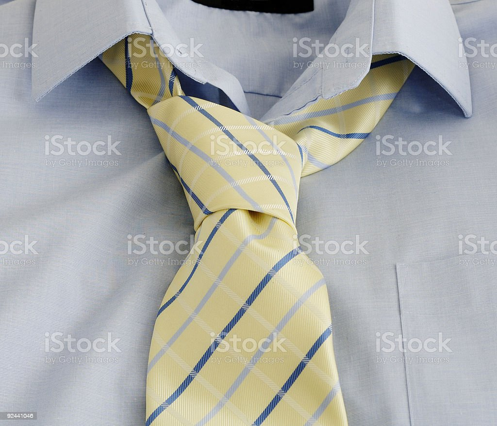Businessman's Shirt and tie laid out against white stock photo