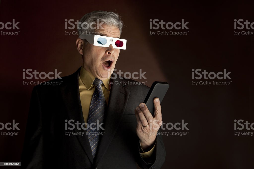 Businessman's 3d viewing experience on a Smart phone royalty-free stock photo