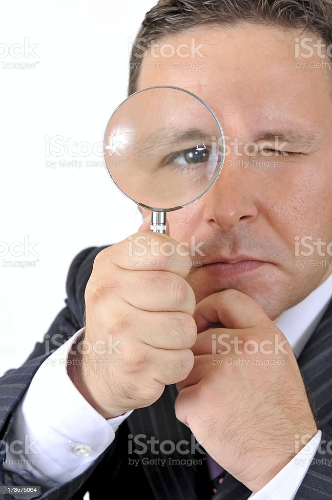 businessman's eye in the magnifying glass royalty-free stock photo