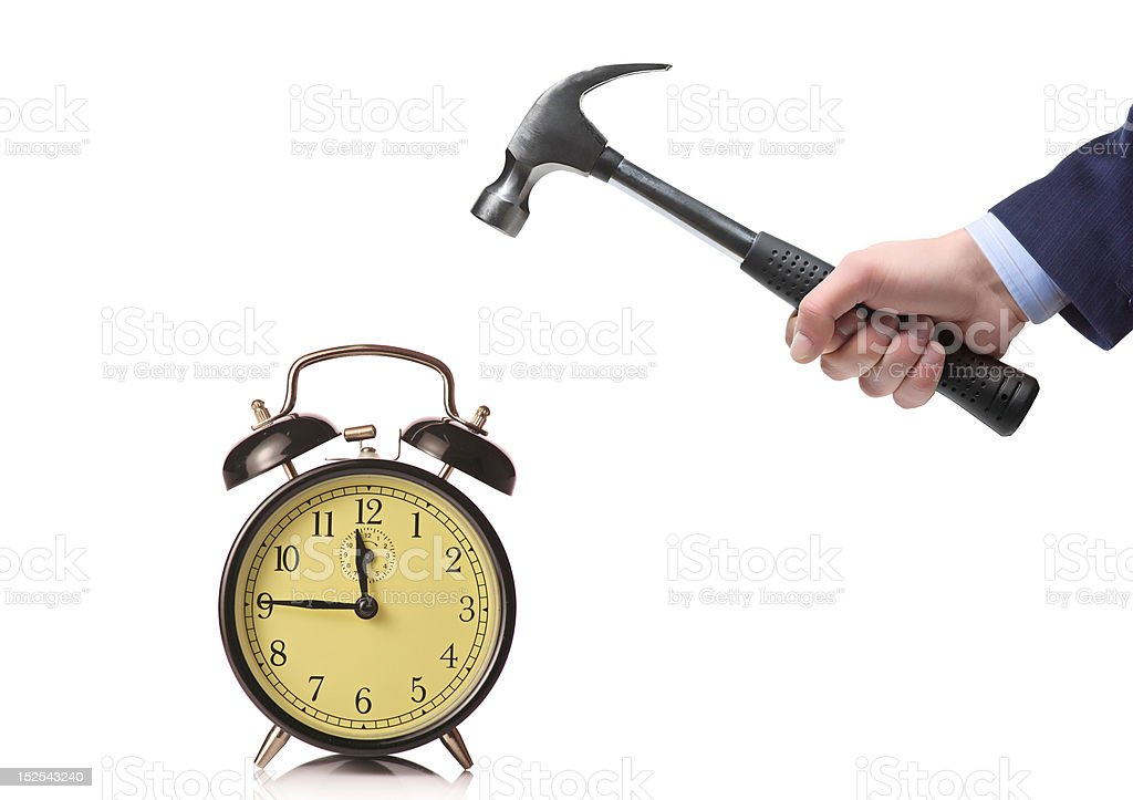 Businessman's hand about to break a clock royalty-free stock photo