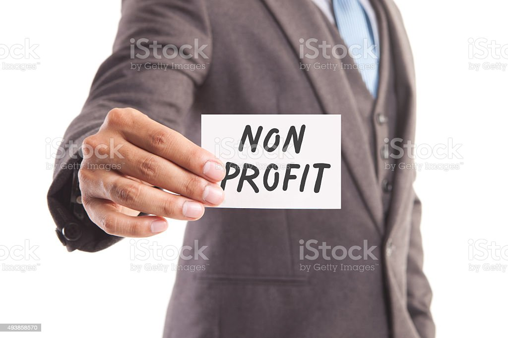 Businessman's hand and non profit message stock photo