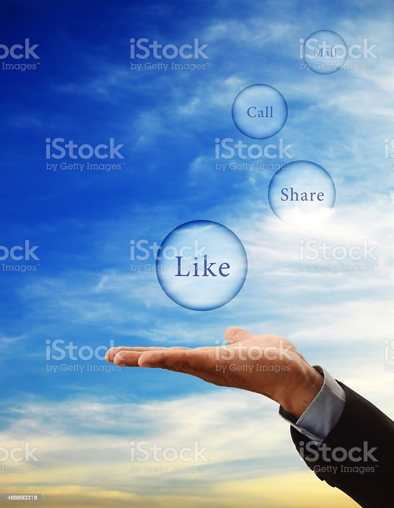 Businessman's hand and social media options stock photo