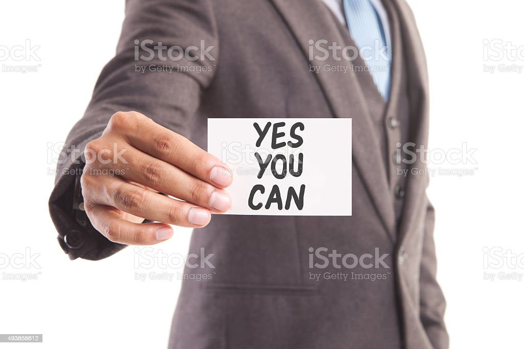Businessman's hand and yes you can message stock photo